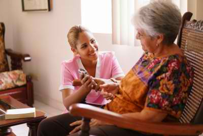 senior woman and female caregiver talking